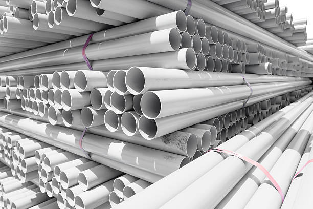 PVC pipes PVC pipes stacked in warehouse. pvc stock pictures, royalty-free photos & images