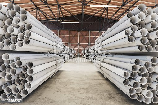 PVC pipes stacked in warehouse