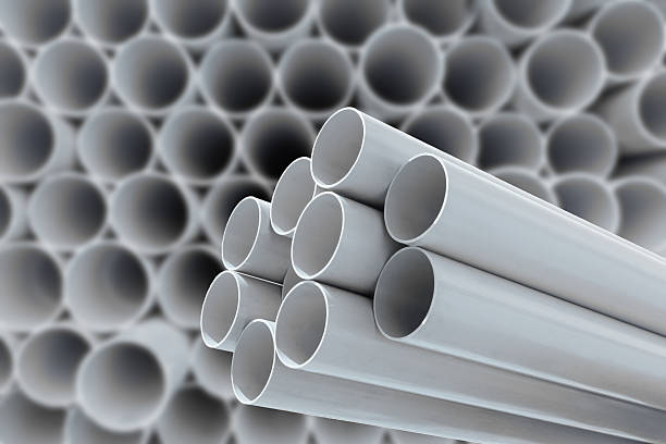 PVC pipes stacked in warehouse. PVC pipes stacked in warehouse. pvc stock pictures, royalty-free photos & images