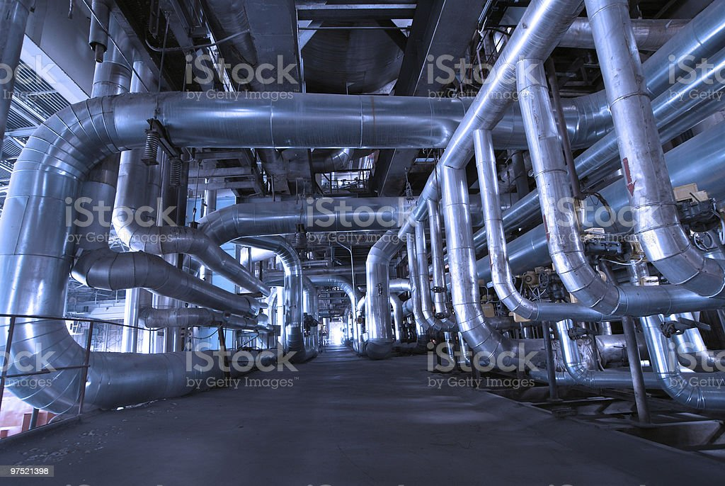 Pipes, tubes on steam turbine at a power plant royalty-free stock photo