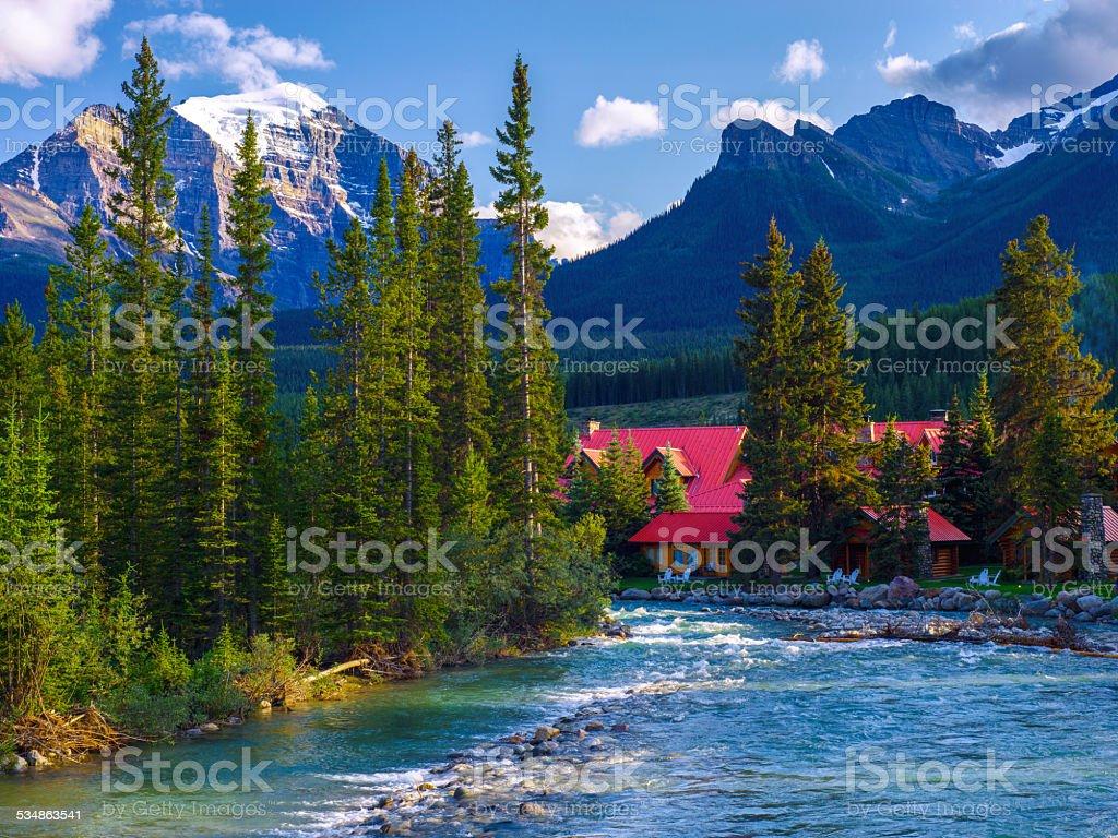 pipestone river, lake louise village cabins stock photo