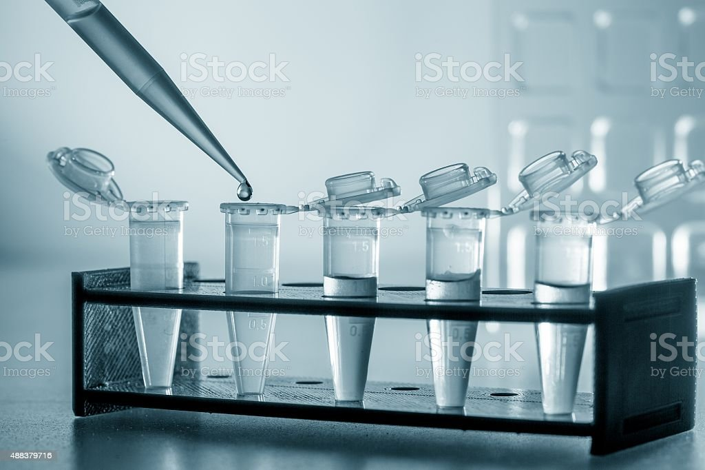 Pipette and test tubes stock photo