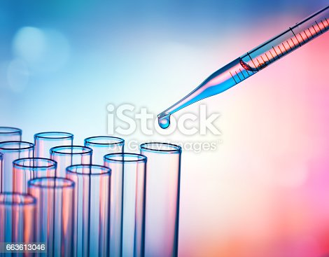 istock Pipette Dropping A Sample Into A Test Tube - Closeup 663613046