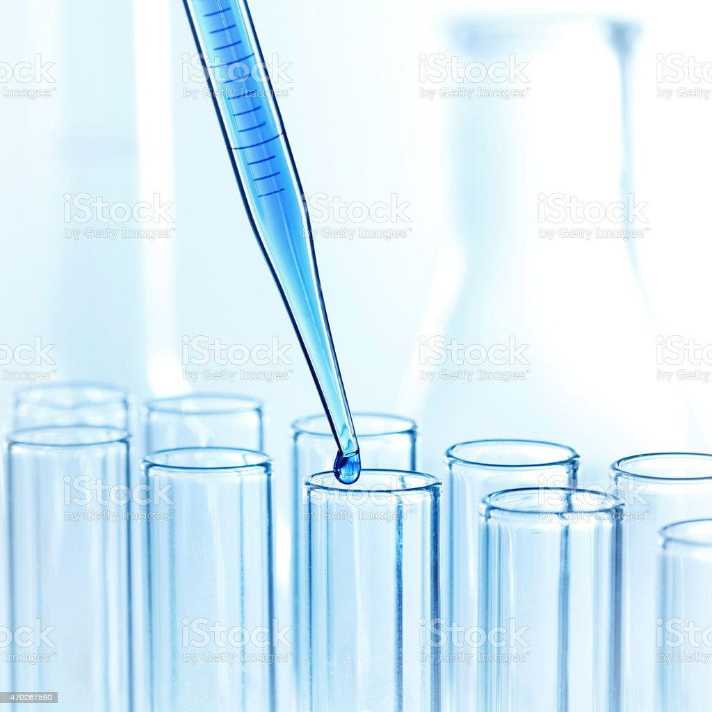 Pipette with drop of liquid stock photo