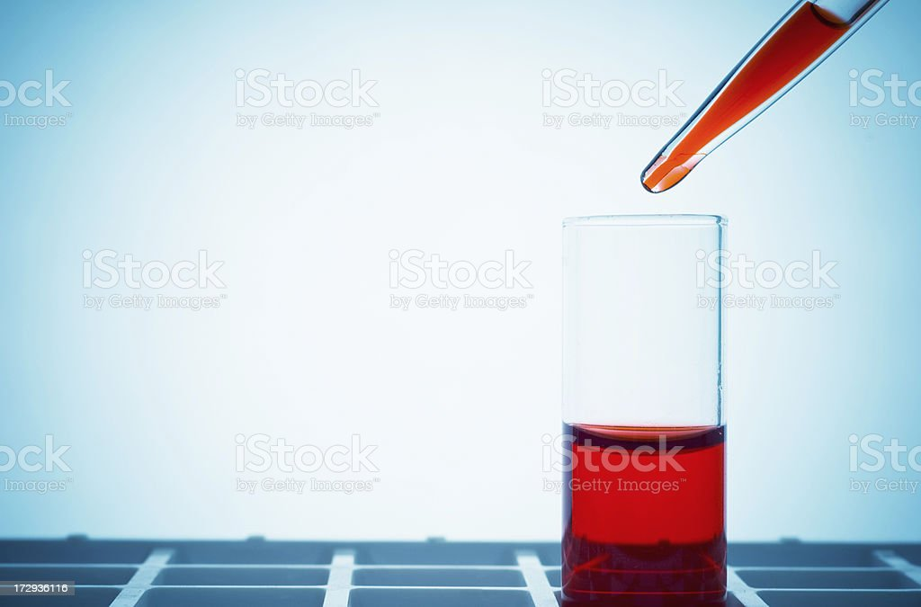 Pipette with red liquid royalty-free stock photo