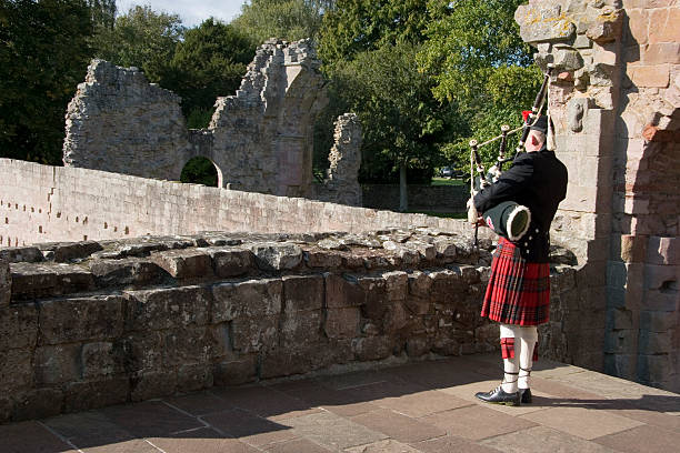 Piping in the Ruins stock photo