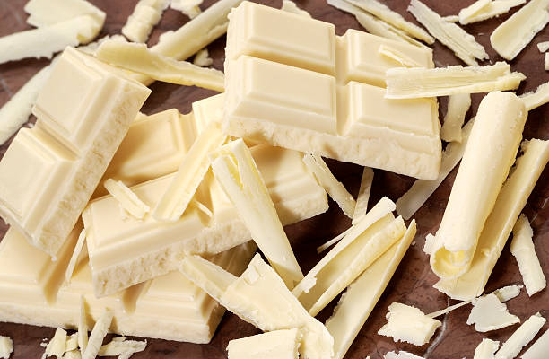 Pips of baking white chocolate pieces stock photo