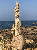 Piramid OF stones in the BEACH OF Salento Italy