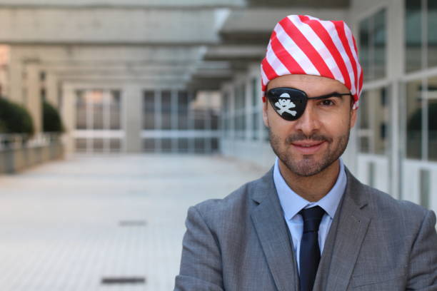 Pirate businessman close up isolated Pirate businessman close up isolated. costume eye patch stock pictures, royalty-free photos & images