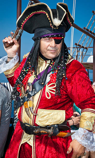 pirate entertains tourists in ormos panagias, greece - swashbuckler stock photos and pictures