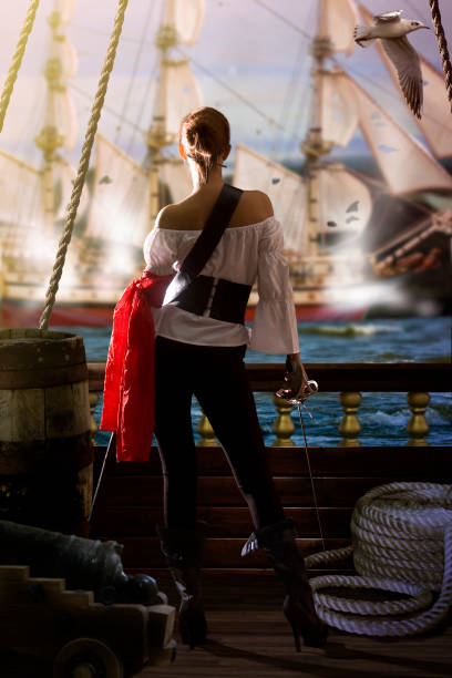 pirate girl attack - swashbuckler stock photos and pictures