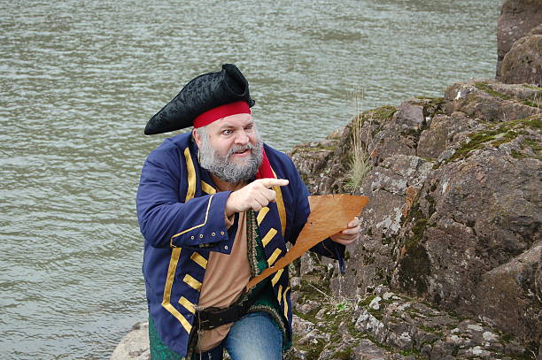 pirate guided by map - swashbuckler stock photos and pictures