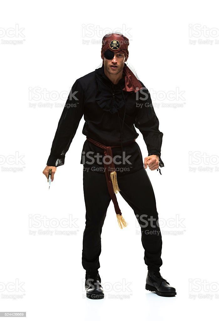 Pirate in action with sword stock photo
