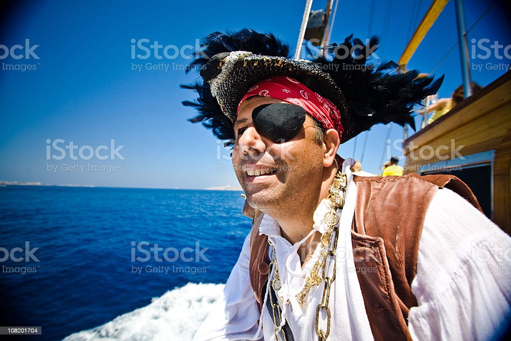 Pirate looking in to the distance off ship stock photo