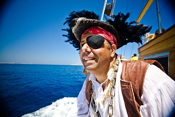 Pirate looking in to the distance off ship  costume eye patch stock pictures, royalty-free photos & images