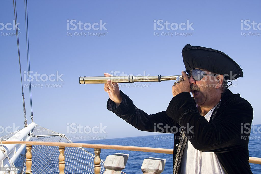 Pirate looking with scope stock photo