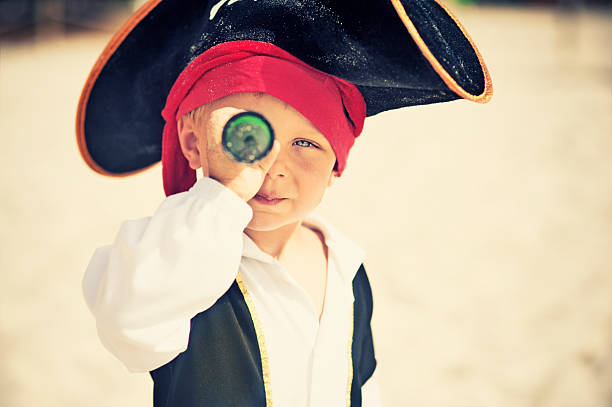 pirate looking with spyglass - pirates stock photos and pictures