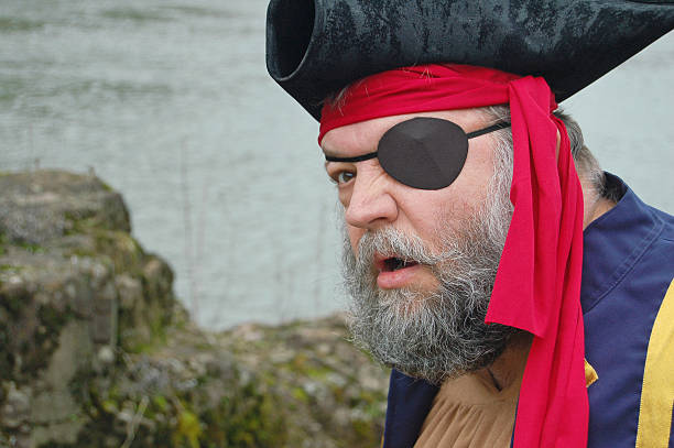 Pirate Profile Salty dog of the seas in profile. costume eye patch stock pictures, royalty-free photos & images