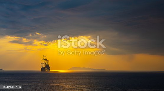 istock Pirate ship at the open sea 1042410716