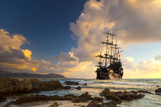 pirate ship at the open sea - pirates stock photos and pictures