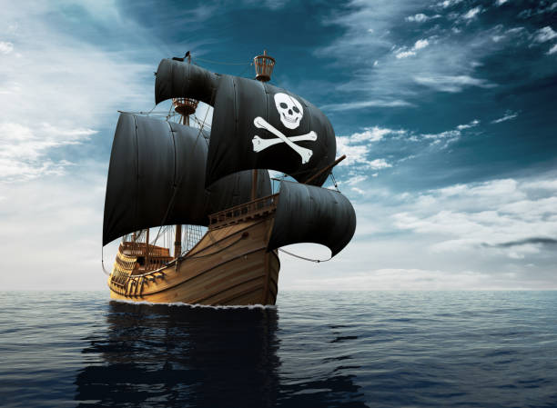 pirate ship on the high seas - pirates stock photos and pictures