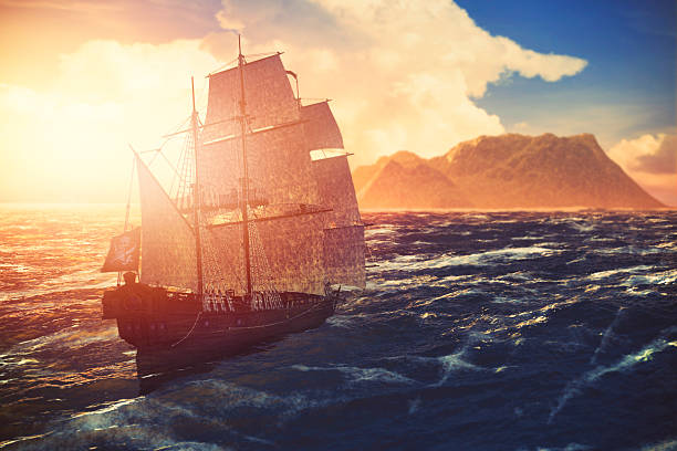 pirate ship sailing towards lonely island at sunset - pirates stock photos and pictures