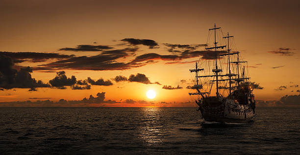 pirate ship silhouette - pirates stock photos and pictures