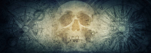Pirate skull and compasses on old grunge paper background. stock photo