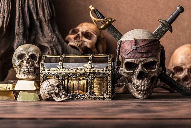 pirate skull concept still life style - pirates stock photos and pictures