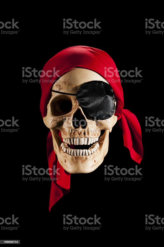 Pirate Skull wearing a red bandanna stock photo