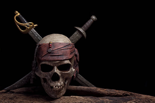 pirate skull with two swords - pirates stock photos and pictures