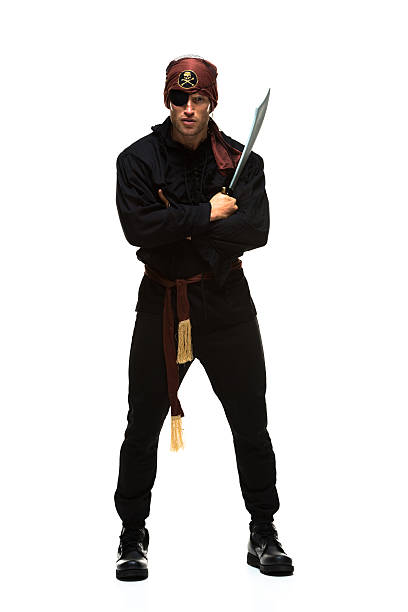 Pirate standing & holding sword stock photo