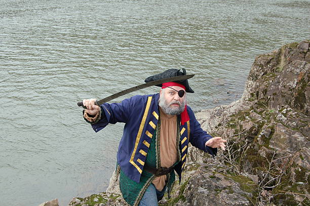 pirate with eye patch - swashbuckler stock photos and pictures
