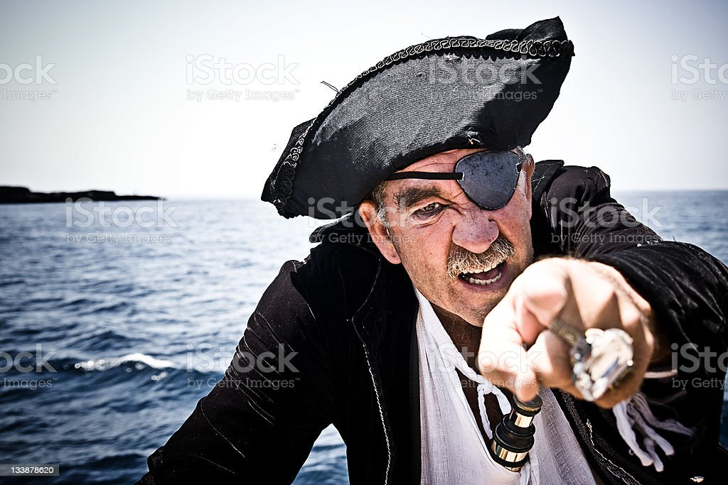 Pirate With Sea Background Pointing At Camera Very Aggressive stock photo