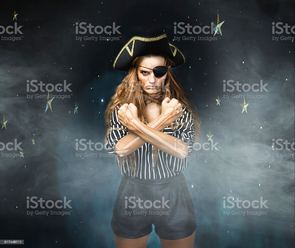 pirate with tatoo skull on body gestures skull flag stock photo