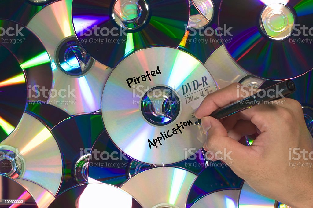 Pirated Applications DVD piled stock photo