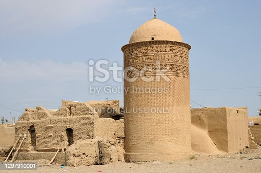 Damgan, Iran - June 26, 2011: The Piri Alemdar Tomb was built in the 11th century. The tomb is built of bricks. The motifs on the top are striking.