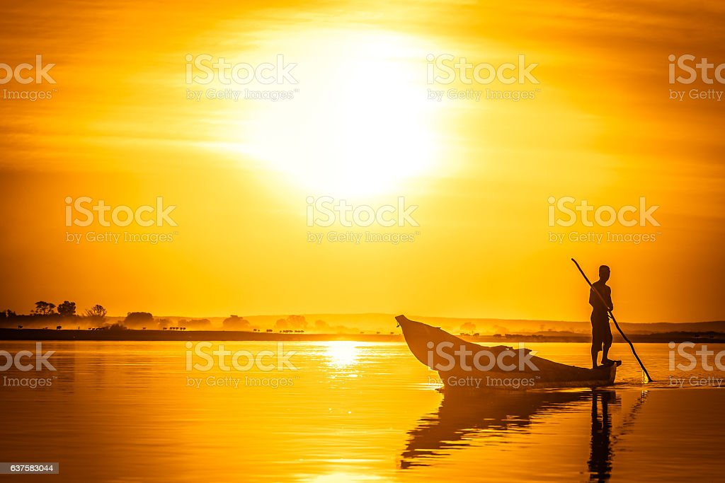 Pirogue at sunset stock photo