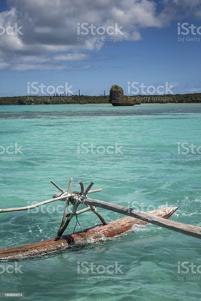 Pirogue Floating on Turquoise Waters, Pines Island, New Caledonia royalty-free stock photo