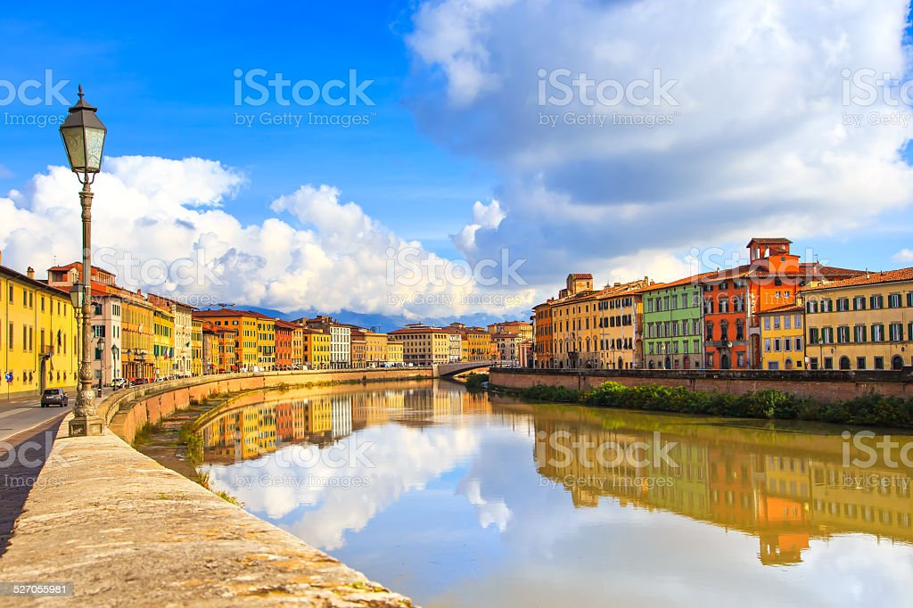 Pisa, Arno river, lamp and buildings reflection. Lungarno view. stock photo