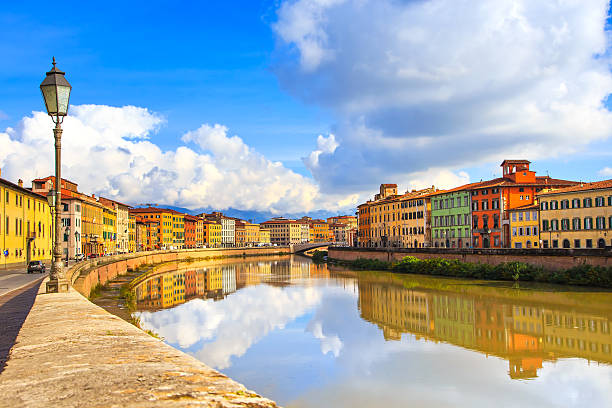 Pisa, Arno river, lamp and buildings reflection. Lungarno view. Pisa, Arno river, lamp and building facades reflection. Lungarno view. Tuscany, Italy, Europe. pisa stock pictures, royalty-free photos & images