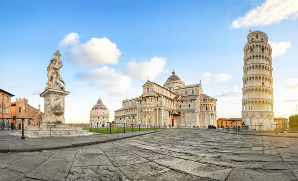 Pisa, Italy. Panoramic view of Piazza del Duomo Pisa, Italy. Panoramic low angle view of Piazza del Duomo square with Leaning Tower, Pisa Cathedral and Putti Fountain pisa stock pictures, royalty-free photos & images