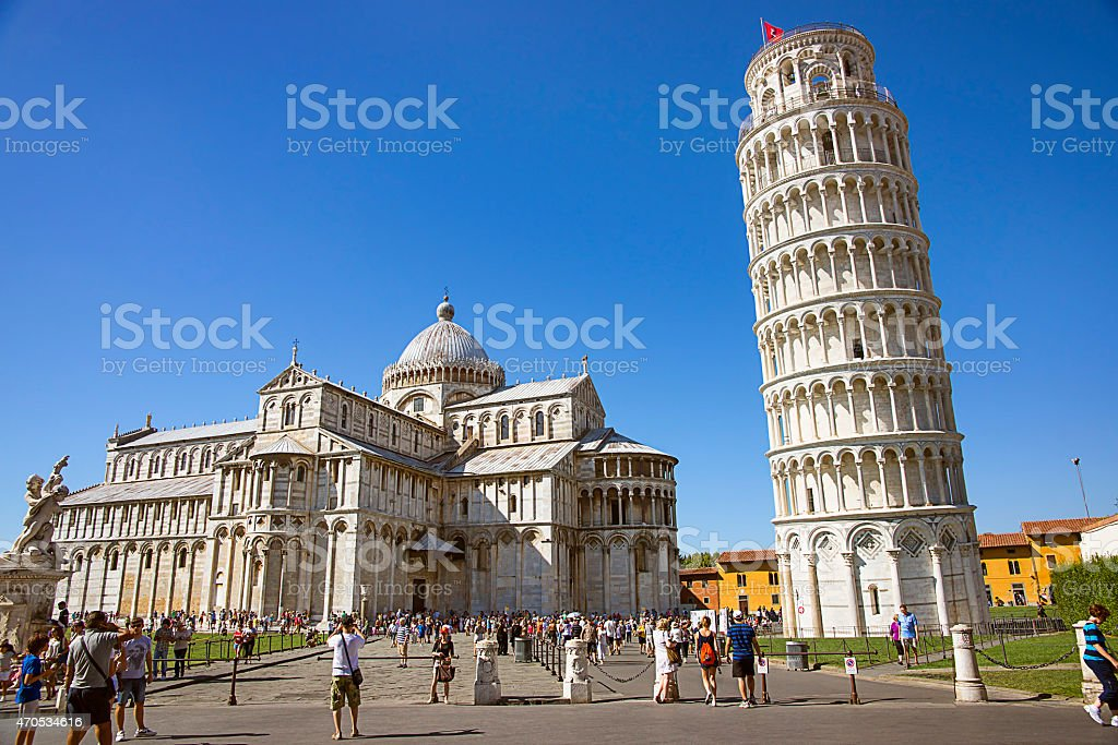 Pisa Leaning tower and Cathedra, and tourists l in Italy stock photo