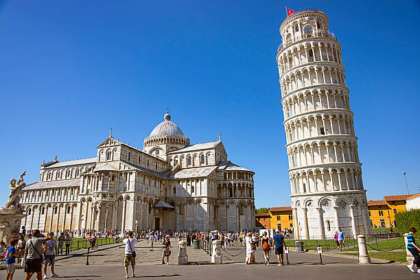 Pisa Leaning tower and Cathedra, and tourists l in Italy Pisa Leaning tower and Cathedra, and tourists l in Italy in summertime pisa stock pictures, royalty-free photos & images