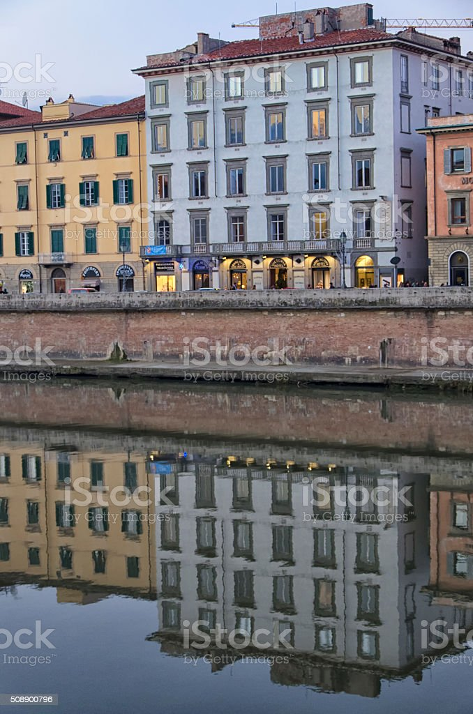 Pisa reflected in the Arno river stock photo