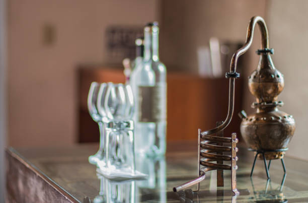 pisco distiller old pisco distiller next to tasting glasses pisco peru stock pictures, royalty-free photos & images