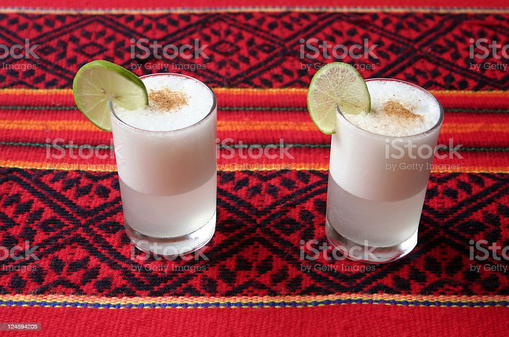 Pisco Sour Traditional cocktail from Peru and Chile. Alcohol - Drink Stock Photo