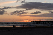 Wonderful view of the sunset and the pier in the city of Pismo Beach, California, USA. Golden hour.