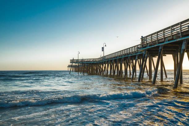 Pismo Beach Pier during Sunset, Pacific Ocean, California Coastline stock photo