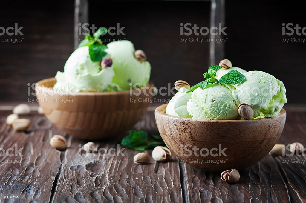 Pistachio icecream with mint and nuts stock photo